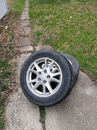 A  matching set of 4 tires an rims GM gently used.