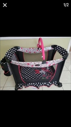 baby's black Minnie Mouse travel coat