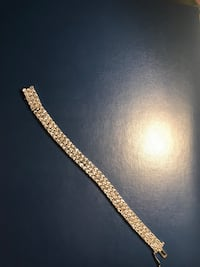 Diamond studded gold bracelet with a hint of gold on the end 39 km