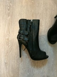 pair of black leather chunky heeled booties Longueuil, J3Y 6K7