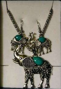Elephant necklace and earrings. Great Falls, 59405