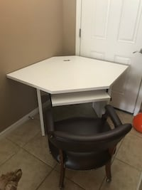 white wooden desk with black rolling armchair Cape Coral, 33909