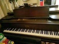 brown and white baby grand piano Roslyn