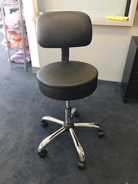 Black leather padded rolling office chair