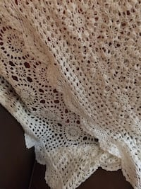 Crocheted tablecloth or bed decor