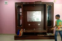 brown wooden TV hutch with flat screen television Bengaluru, 560008