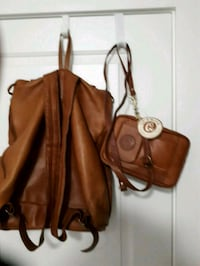 brown leather zip-up backpack