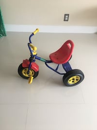 Toddler's red, blue, yellow tricycle. Like new hardly ever used Hallandale Beach, 33009