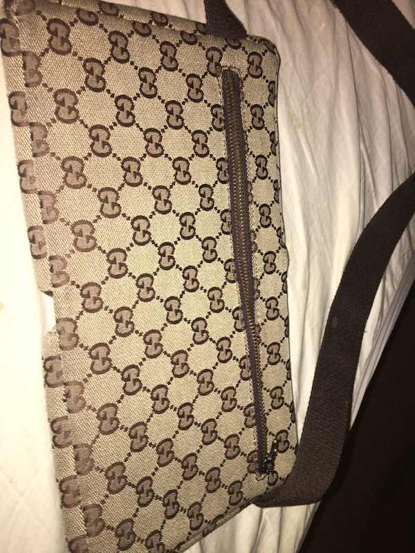 brown and black Gucci belt