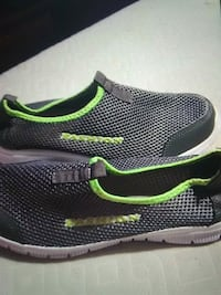 pair of black-and-green Nike running shoes Bristol, 24201