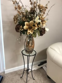 Floral arrangement with glass vase