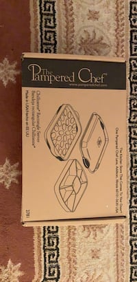 The pampered chef rectangle server can use for deviled eggs etc. Never used never out of the box