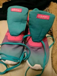 pair of teal-and-pink Nike basketball shoes