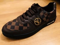 unpaired svart och brun Gucci low-top sneaker