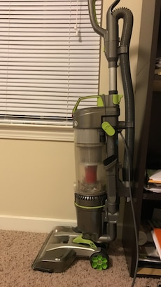 black and green vacuum cleaner
