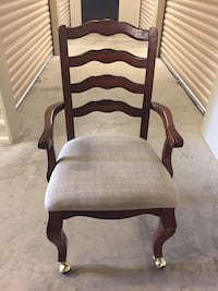 Wooden framed cream padded chair.  Excellent condition on coasters for easier mobility.   Germantown, 38139