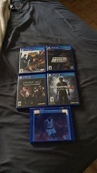 Four sony ps4 game cases Windsor, N8W 5M9