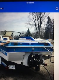 Blue and white speed boat 1990 sunbird