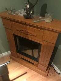 Brown wooden framed electric fireplace Waterloo, N2L 4G1