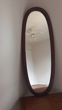 brown wooden framed wall mirror Ellicott City
