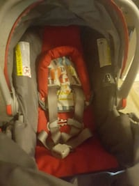 baby's red and gray car seat carrier Washington, 20011
