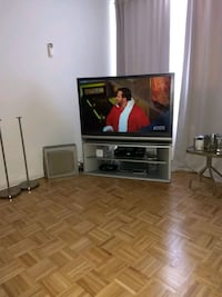 black flat screen TV; white wooden TV stand Montreal, H1S 3G5