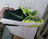 unpaired black and green Nike basketball shoe Evansville, 47710