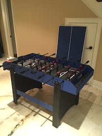 blue and black foosball table