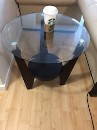 round glass top table with black wooden base Edmonton, T5H