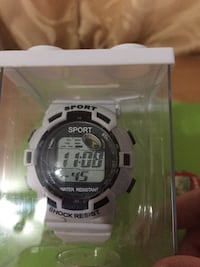white and black digital watch with white band