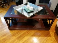 rectangular glass top coffee table with brown wooden frame Philadelphia, 19119