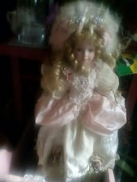 girl in pink and white ball gown porcelain doll