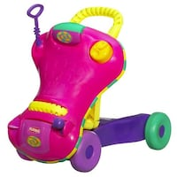 Pink, yellow, and purple playskool learning walker, like new very well kept, non smoking home. Mascouche, J7K 3T1