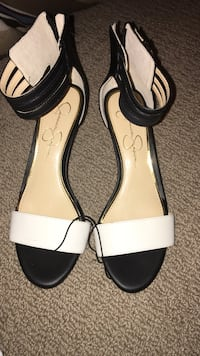 women's pair of black-and-white leather sandals