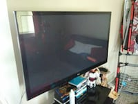 black flat screen TV with remote Greeley, 80634