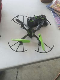black and green quadcopter