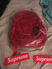 red Supreme backpack with plastic pack New York, 10026