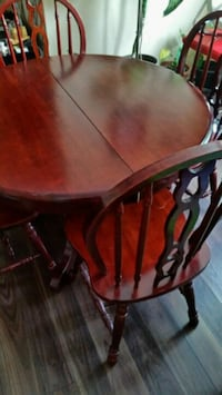 round brown wooden table with four chairs dining s Toronto, M3L 1E9