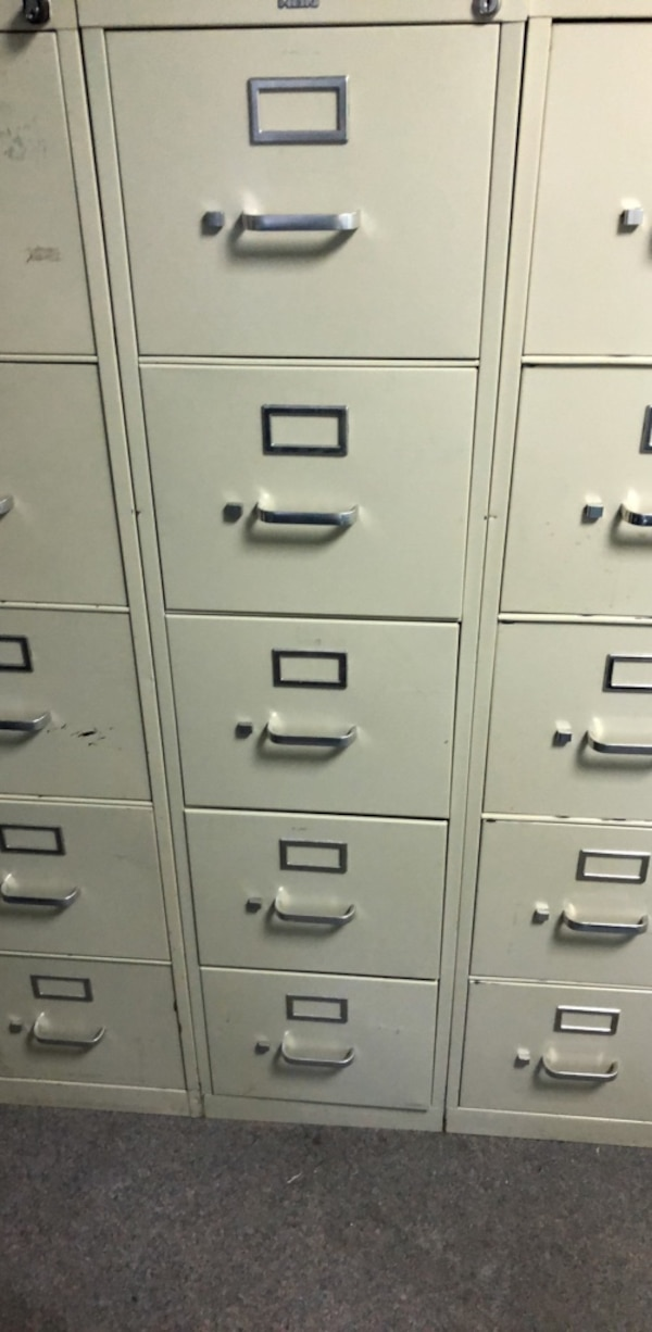 Two gray metal 4-drawer filing cabinets