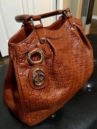 brown monogrammed Gucci leather shoulder bag   Well kept. Non smoking home