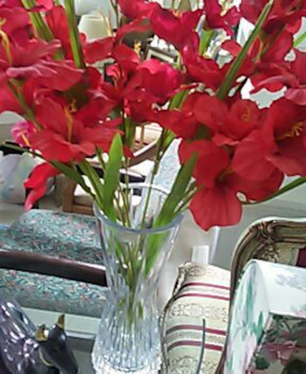 Used Red Hibiscus Flower Arrangement In Clear Cut Glass Vase For
