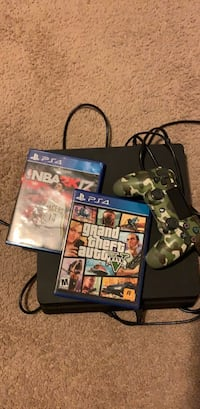 black Sony PS4 with controllers and game cases Houston, 77077