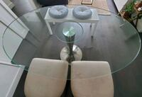 Oval clear glass dining table