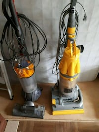 yellow and gray upright vacuum cleaner