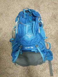 blue, white, and black Xenith 88 hiking backpack