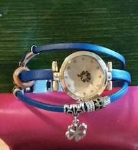 round silver analog watch with blue leather strap Calgary, T2J 0B9
