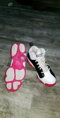 pair of white-and-red Air Jordan 13 Silver Spring, 20902