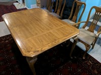 rectangular brown wooden table with chairs dining set Calgary, T3M 1S1
