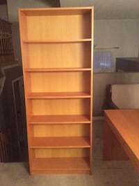 Brown wooden bookcase and matching computer desk