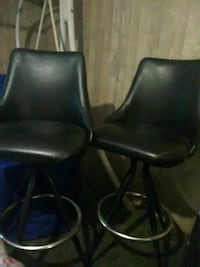 two black leather padded chairs Albuquerque, 87107